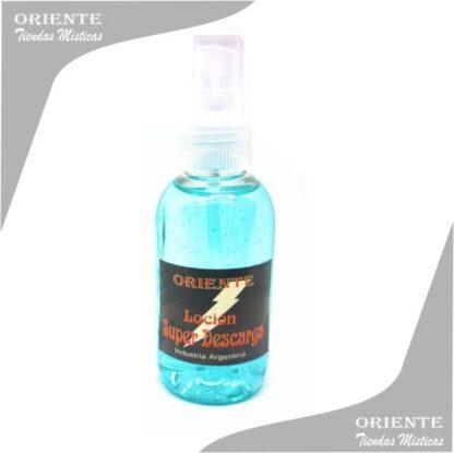 Locion super descarga , de color celeste con etiqueta de cristo con los brazos abierto también denominado spray aurico descarga o perfume de descarga