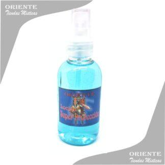 Locion super proteccion , de color celeste con etiqueta de cristo con los brazos abierto también denominado spray aurico protección o o perfume protección