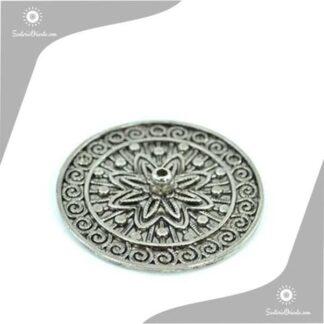 Portasahumerio flor de loto metal sobre relieve
